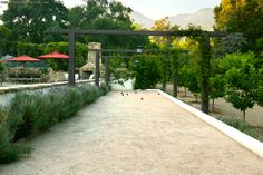 Southern California Living--Fireplace and Seating, Bocce Ball Court, and Citrus Trees http://paulhendershotdesign.com/