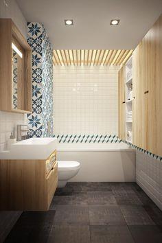 carrelage anthracite texturé au sol, carrelage blanc aux murs, mobilier bois clair et effet de mosaïque bleue vintage