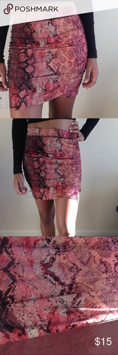 "Print Side Ruched Mini Skirt This snakeskin Moda International mini skirt, is perfect for going out! Fitted with great stretch. Fabric is 95% Viscose and 5% Elastaine- soft and comfortable! Skirt gives great coverage-not see through. Item like new- only worn once.  Pictured High waisted with a crop top but you can pull it down and wear it right at waist line.   Measurement laying flat: Waist 13"" across                                                 Waist to Hem- 18"" Moda International…"