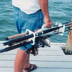 I'm sure a competent wood worker could make one of these as a gift for a fellow fisherman!  Taco Tote-Em 4-Rod Carrier-92559 - Gander Mountain