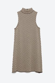The Party Dress Trends You'll See Everywhere #refinery29  http://www.refinery29.com/red-carpet-holiday-dresses-guide#slide-12  Layer this dress over a long-sleeved T-shirt or thermal, and the cold doesn't stand a chance.Zara Micro Jacquard Dress, $49.90, available at Zara....