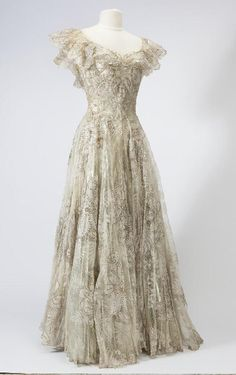 Women's 1948 Veiled Prophet Queen dress of (once) off-white lace over silver lame. Dress is now tarnished and gold. Missouri History Museum. collections.mohistory.org #fashionhistory #1940sstyle