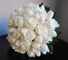 White tulips and roses bridal bouquet.