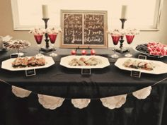 Yummy treats, and a DIY pennant flag. Simple candles create the mood for a loving baby shower.