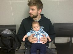 Dada Style: Shakira's adorable men (partner Gerard Pique and baby Milan) waiting to get a baby passport with their trusty Petunia Pickle Bottom Central Park North Stop Sashay Satchel in tow!