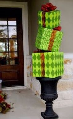 Wrap boxes in vinyl tablecloth for outdoor decorations