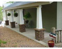 Porch columns on this lake house were updated with Craftsman style using faux stacked stone column wraps. See before and after photos. Stone Porches, Brick Porch, Porch Wood, Front Porch Pillars, House Front Porch, Porch With Columns, Front Deck, Brick Columns, Stone Pillars