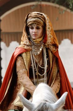 Sibylla is a prime example.  She wears styles indicative of the Holy Land during the time, but with European touches.