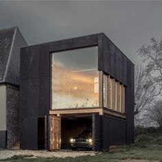 This blackened plywood box added by architect Antonin Ziegler to one end of a rural home on France's northern coast provides a private library and garage for its inhabitants. See our recent Instagram posts for more examples of striking black houses, or visit dezeen.com/tag/black-houses #architecture #house #France