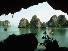 """Ha Long Bay (or Halong) in Vietnam    Ha Long means """"descending Dragon"""" because, according to legend, a group of dragons descended from heaven as a gift from the gods to the ancient Vietnamese people, in order to help them fight their enemies. Those dragons spat out jewels and jade, which eventually became rock thousands that populated the bay. In addition, the larger islands are no others than the petrified family of dragons."""