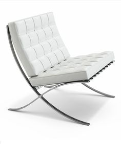 Barcelona Chair designed by Ludwig Mies van der Rohe (1929) Modern chair with chrome legs and leather cushions. Since 1953 Knoll Inc has manufactured the chair. His signature is stamped into each chair.