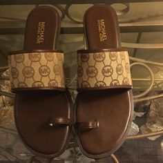 Michael Kors Sandals 10M Michael Kors toe thong sandals. Only worn in excellent condition. These are a rare find. Serious offers please. What you see today could be gone tomorrow. Michael Kors Shoes Sandals