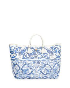 Floral-Print Shopper Bag, Blue/White by Dolce & Gabbana at Neiman Marcus.  It's a pretty bag, but why the heck did they out the inside pocket stitching through the bag, on both sides!  It looks horrid.