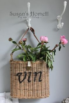 Thin hanging basket with pink flowers
