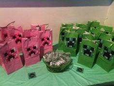 The goodie bags were green creepers for boys and pink for girls.  They were packed with home Mine Craft stuff that I will load pictures of.