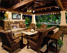 Impressive Patio Design Ideas - Style Motivation A big screen TV under a covered patio would be such a great addition to your backyard!A big screen TV under a covered patio would be such a great addition to your backyard! Outside Living, Outdoor Living Areas, Outdoor Rooms, Outdoor Patios, Outdoor Dining, Outdoor Stone, Rustic Outdoor, Outdoor Seating, Indoor Outdoor