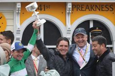 Matt Bryan Photos - From left jockey Kent J. Desormeaux, trainer J. Keith Desormeaux, and principal owner Matt Bryan, celebrate after Exaggerator won the 141st running of the Preakness Stakes at Pimlico Race Course on May 21, 2016 in Baltimore, Maryland. - The 141st Running of the Preakness Stakes