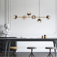 Imagine having to work in a place that inspire you, and where you feel comfortable in. This amazing space, ideal for working, drawing, creating, and developing, has never looked better. An office, or a studying area needs to be well-decorated as much as your living room. See how our beautiful 6-light sputnik linear pendant light resembles with the small grey and brown stools, and the large grey desk. Uniform, and serious colors, need lighting pieces on their surrounding to brighten up the…