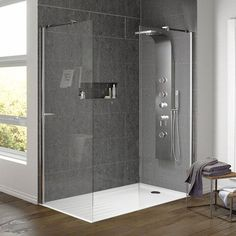 If you use pale floor tiles the shower tray will almost disappear.  On a budget I think low sided shower tray will be more cost-effective then a tiled wet room floor - check with builder.  you only need side panel (you don't need the end panel shown here)
