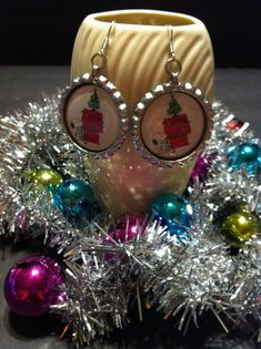 Check out this item in my Etsy shop https://www.etsy.com/listing/209645639/snoopy-christmas-earrings-silver-tone