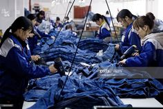 Workers manufacture blue jeans in Congshin textile factory on February 9, 2012 in Xintang, Guangdong province, China.The town of Xintang, nicknamed 'the denim jeans center of the world, claims to produce 60% of the world global output of jeans.
