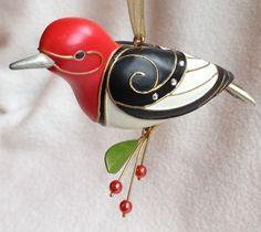 One Hallmark Christmas Ornament Red-Headed Woodpecker dated 2009. Fifth in the Beauty of the Birds Series. Edythe Kegrize Hallmark Keepsake Artist.