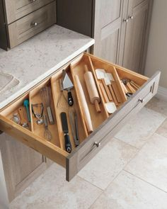 Great ideas for kitchen solutions! Angled drawer dividers make it easy to store longer utensils, like rolling pins, and free up valuable countertop space. Shop more kitchen solutions from Martha Stewart Living at The Home Depot. Kitchen Ikea, Farmhouse Kitchen Cabinets, Diy Kitchen Storage, Kitchen Cabinet Organization, Home Organization, New Kitchen, Kitchen Decor, Smart Kitchen, Cabinet Ideas