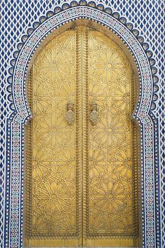 "Golden door. Morocco.  Gold, also called golden, is one of a variety of yellow-orange color blends used to give the impression of the color of the element gold. The web color gold is sometimes referred to as golden to distinguish it from the color metallic gold. The use of gold as a color term in traditional usage is more often applied to the color ""metallic gold"" ."
