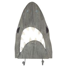 Add some cool style - with a splash of practicality - to your little one's space with the Shark Wall Decor with Hooks from Pillowfort™. Crafted from wood and shaped like a shark rising up with its jaws open, this piece of wall art is as functional as it is fun, thanks to the two bottoms hooks, which are perfect for hanging hats, necklaces, scarves and other small accessories. Simply hang it on the wall as the finishing touch to an underwater-themed room.
