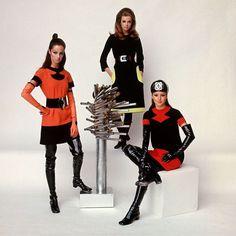 "From the Aug. 30, 1968 fashion feature: PARIS decrees black as the big color—in traditional couture and in the new ready-to-wear. This image was featured with the following caption: ""CARDIN. Surrounding a piece of sculpture which is part of the decor..."