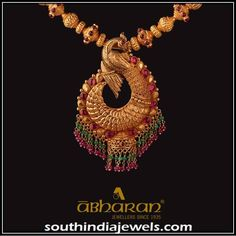 Gold Antique peacock pendant from Abharan Jewellers