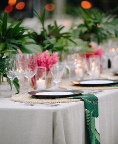 Elegant tropical wedding table  PC:  Meg Smith Photography  Design + Planning: Jenna Lam Events Venue: @Travaasa   Flowers: Teresa Sena Design Linens: La Tavola Linen Table Settings: Set