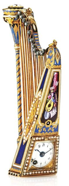 BESSIÈRE & SCHNEIDER A FINE AND RARE GOLD, DIAMOND, ENAMEL AND PEARL-SET MUSICAL WATCH IN THE FORM OF A HARP CIRCA 1820