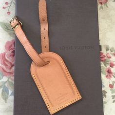Authentic Louis Vuitton luggage tag Larger size authentic Liyis Vuitton luggage tag. Great condition with normal, even patina. Hardware has some small wear, but overall, great. Tag only, no box Louis Vuitton Accessories Key & Card Holders