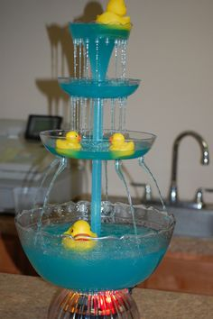 Rubber Duckies Baby Shower Party Ideas Punch fountain at a Rubber Duckies Baby Shower! Ducky Baby Showers, Baby Shower Duck, Rubber Ducky Baby Shower, Baby Shower Gender Reveal, Baby Shower Games, Shower Party, Baby Shower Parties, Rubber Ducky Party, Rubber Ducky Punch