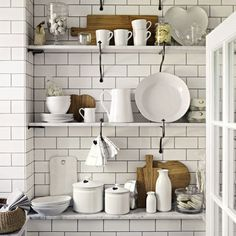 White accessories in a white kitchen from The White Company. Love how fresh this kitchen space looks. Kitchen Shelves, Kitchen Storage, Kitchen Decor, Kitchen Ideas, Kitchen Tile, Kitchen Designs, Kitchen Styling, Fancy Kitchens, Home Kitchens