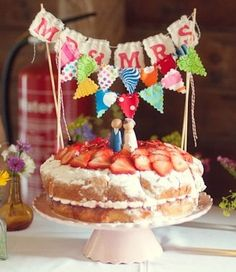 adorable cake topper on a rustic cake