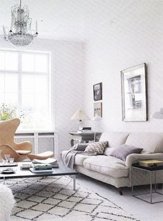 The beckoning sofa, the elegant chandelier and the eclectic mix and match of styles. Adore.
