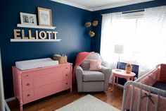 Navy blue and coral pair so well together for a bold, colorful nursery!