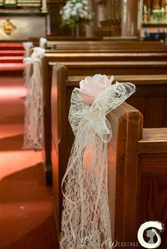 Wedding aisle decorations - lace bow pew ends with single pink rose - Laurel Weddings http://www.laurelweddings.com/blush-pink-and-ivory-flowers-at-mottram-hall/