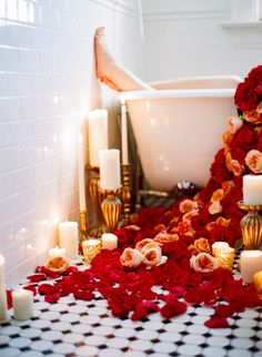 A Floral Carpet of Roses  + a Long Leisurely Soak on Valentine's Day. Yes, Please!! Floral Design: CoriCook.com    MicheleHartPhotography.com    See more on SMP: http://www.StyleMePretty.com/colorado-weddings/denver/2014/02/14/peach-red-valentines-day-shoot/