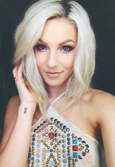 AlisonLovesjb. She is so beautiful. She looks like the young Christina Aguilera to me.