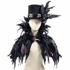 """Wrap yourself in our stunning Feather Cape and the compliments will flock in. """"Dramatic"""" doesn't begin to describe its haunting beauty."""