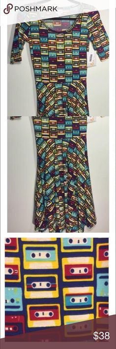 ✂️✂️XS LuLaRoe Nicole Dress 🌱Brand New 🌱In Pkg. Fits 2-4. XS Nicole Dress with Red, Blue, Green and Gold design on a navy background. Fun and flattering! Great for the fall. Bundle&Save. LuLaRoe Dresses Midi