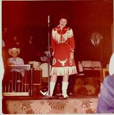 The much loved Patsy Cline in the 1950s wearing a fabulous red fringed western shirt and skirt