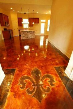 Fleur de lis concrete stained floor