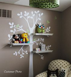 love this - could easily be used in a living room/family room/reading nook - i see owls, birdhouses, etc. on the shelves! so cute!