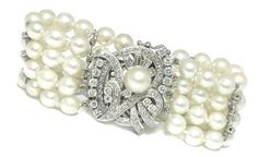 This is a beautiful four strands pearl diamond 14k white gold flower clasp bracelet.  - Outfit 177