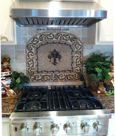 custom kitchen backsplash design with fleur de lis
