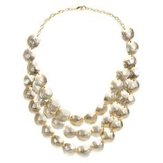 """Colette offers contemporary boldness that accents your look without overpowering it. The cascading silhouette of 3 rows of dazzling matte satin gold shells will catch the light with your every move. This 16"""" necklace (+2"""" extender) will be your go-to piece all summer long."""